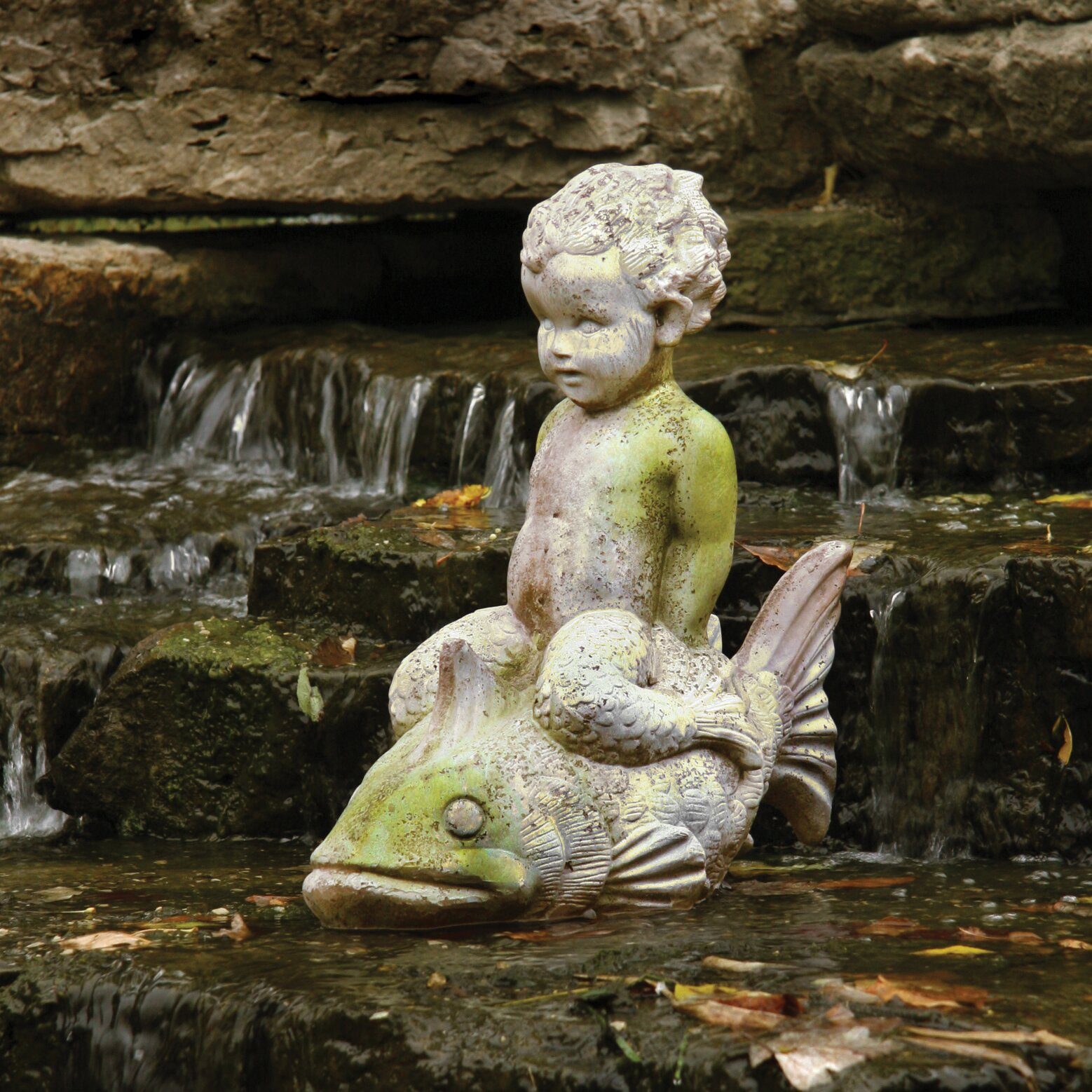 Orlandistatuary animals boy on fish garden statue for Fish garden statue