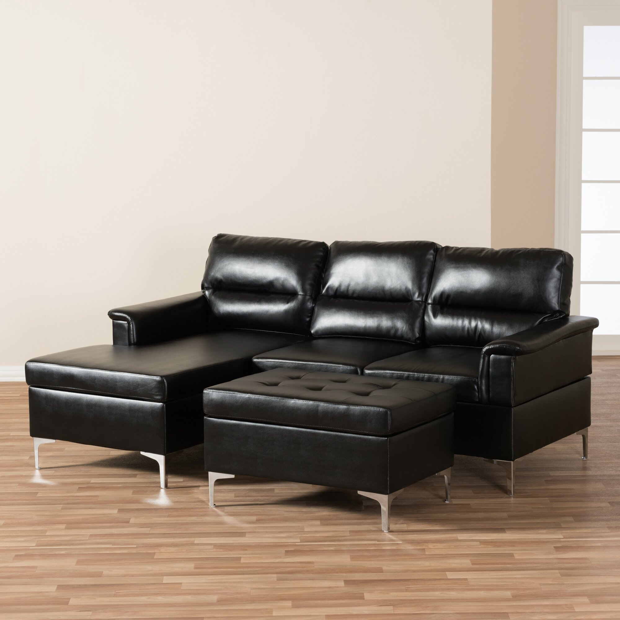 Wholesale interiors baxton studio teresa sectional for Small spaces sectional sofa black faux leather