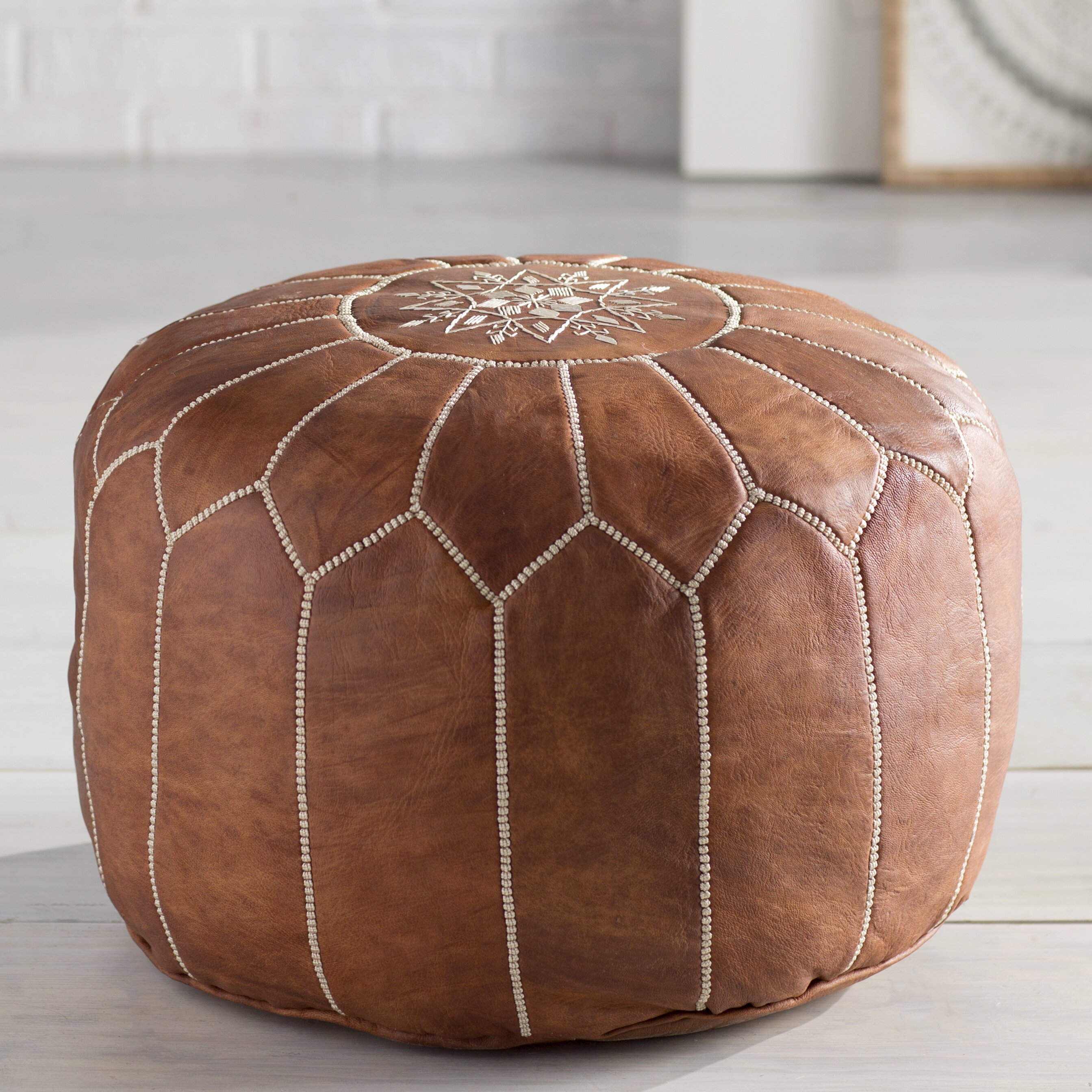 bungalow rose soukaina leather pouf ottoman reviews wayfair. Black Bedroom Furniture Sets. Home Design Ideas