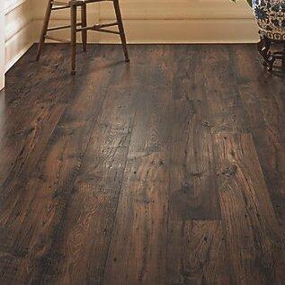 Mohawk rugged vision 8 x 54 x chestnut laminate for Dark brown laminate wood flooring